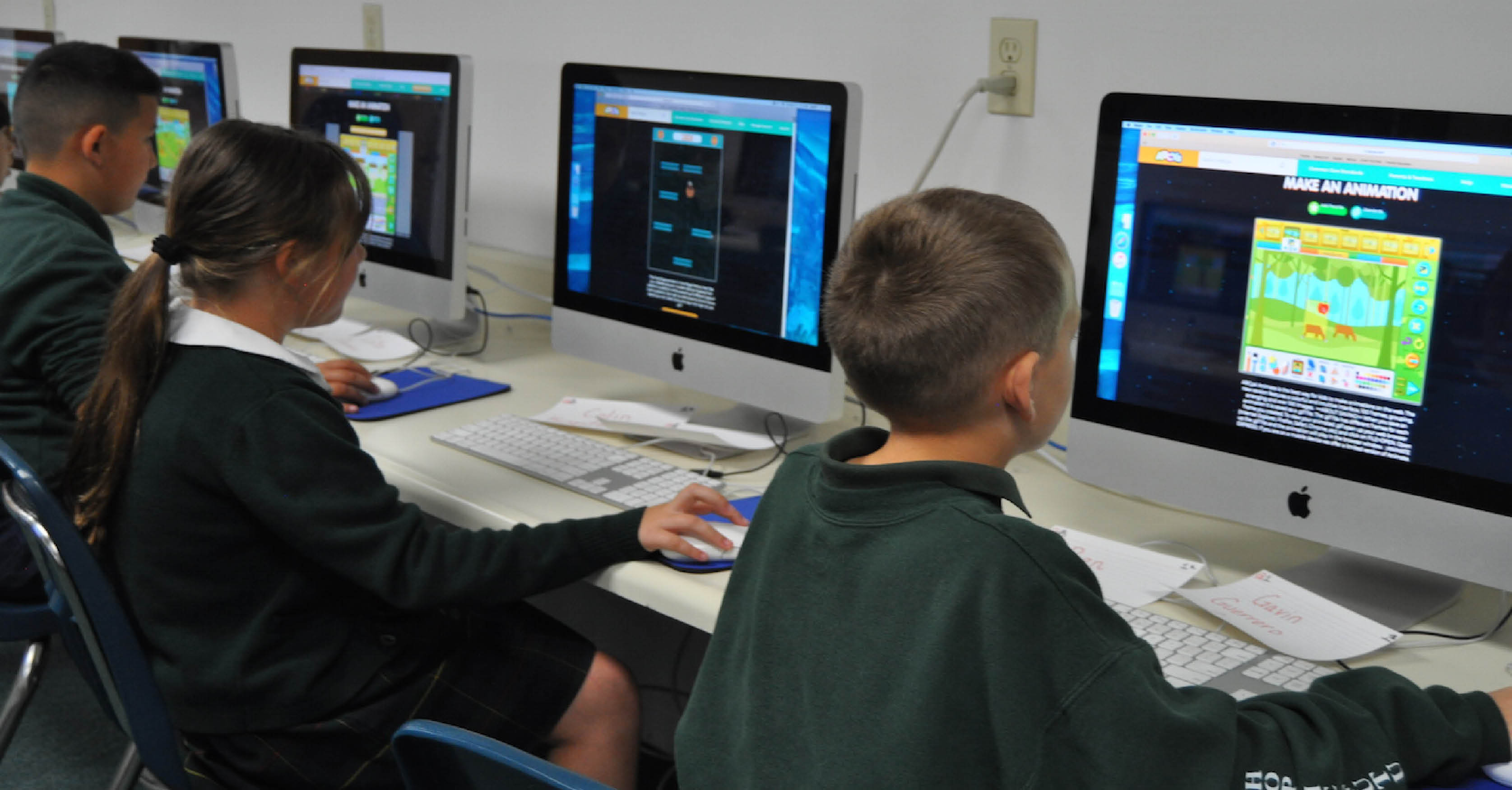 Students learn animation in computer class.